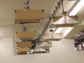 Close-up View of Overhead Box Delivery Conveyor System